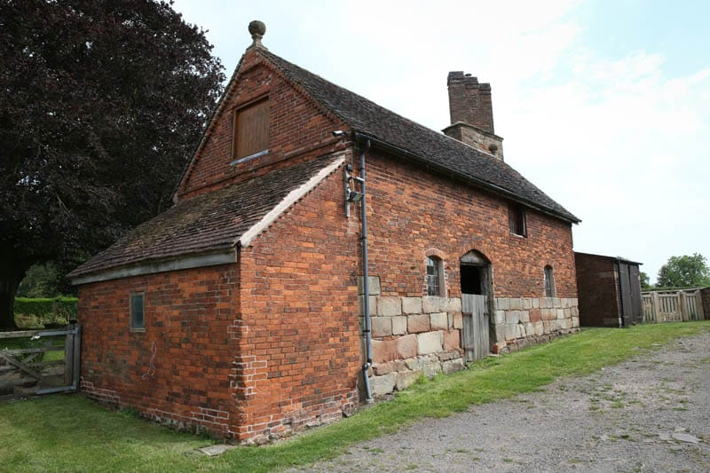 View of Colliers Oak Farm Barn showing heritage windows
