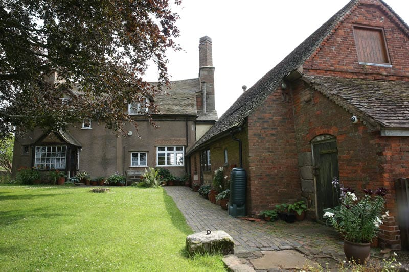Rear view of colliers oak farm showing the barn and farm house with new casement windows