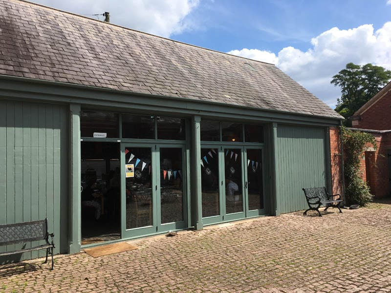 Halifax sliding bifold folding doors 3 three panel cafe painted green stable external courtyard elevation