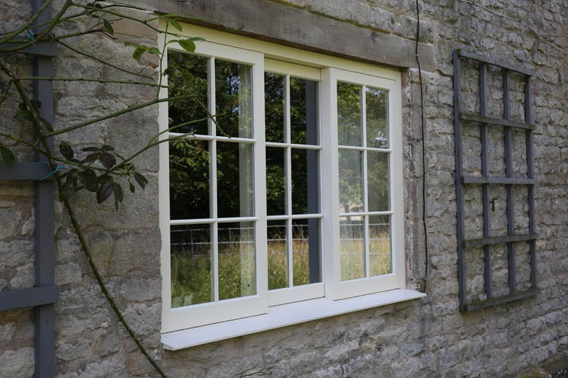 Belton horizontal sash window in heritage project installation by Gowercroft Joinery from left