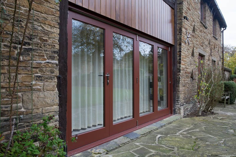 Heritage bifold doors in barn conversion from outside by Gowercroft