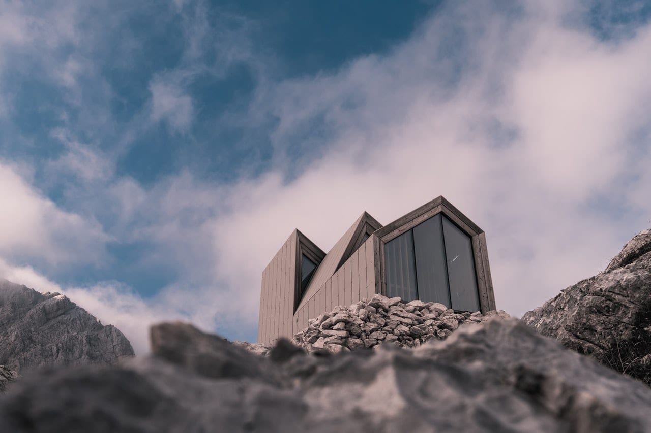 photo-of-building-on-top-of-rocks-3312662
