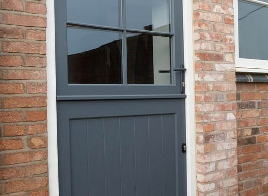 Melbourne stable door Stephenson leaf white frame painted panel bottom groove brick external view close up