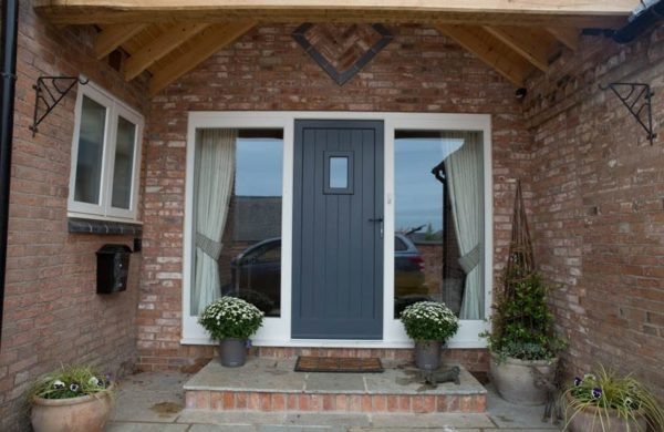 Single Melbourne door Stephenson leaf white frame painted brick side panels direct glazed vision panel grooved