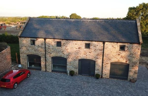 High elevation shot of Duston Barn with clear views of the Hardwick Flush Casement Windows and Melbourne entrance Doors