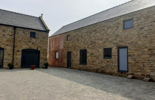 The main courtyard at Dunston Farm showing the wide variety of windows and doors for barn conversions