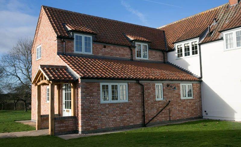 Replacement Windows White Cottage extension Hardwick casement duck egg blue elevation brick render clay tiles