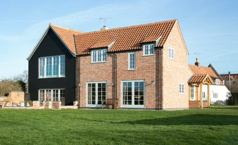 Replacement Windows White Cottage Side Elevation with Hardwick casement and Melbourne French doors with brick work and black cladding timber