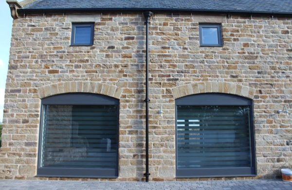 Some of the large fixed glazing windows in the Dunston Barn Project