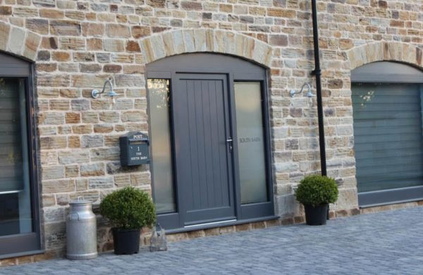 One of the front doors for barn conversions with radial scribe top at Dunston Barn Conversion