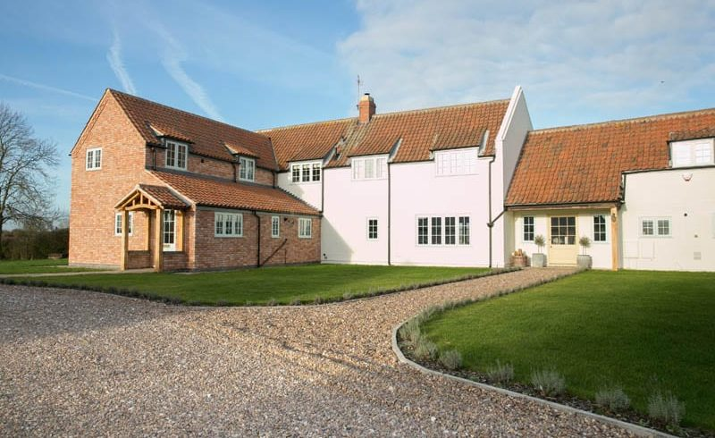 White Cottage replacement windows main image showing hardwick timber casement windows and the extension to the property