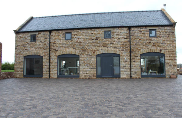 Low angle photo of Dunston barn with modern windows for barn conversions