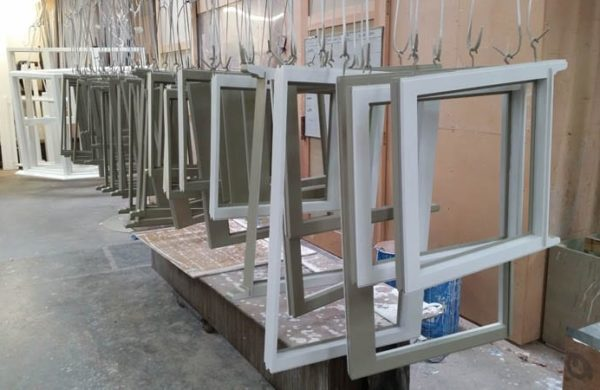 Heritage windows waiting for finishing in the paint department