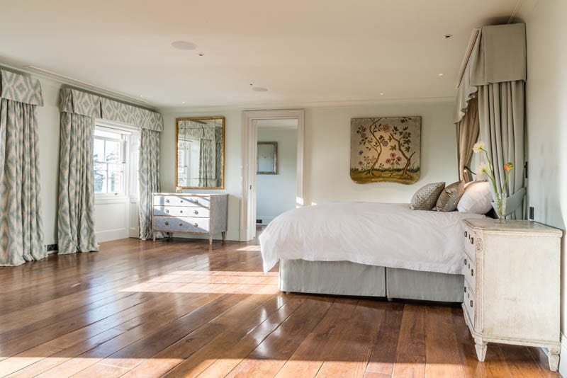 Bedroom at Templeton House in London after renovation showing heritage windows by Gowercroft Joinery