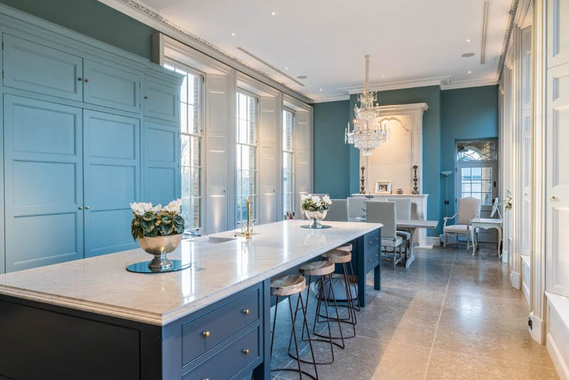 The kitchen at Templeton House painted a lovely blue colour with chandelier