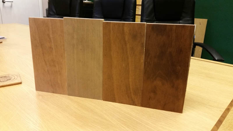 Accoya window frame stain samples on a desk in the Gowercroft office