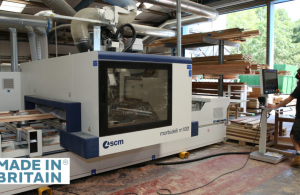 Made in Britain logo superimposed over a photo of a CNC router window making machine in the Gowercroft factory