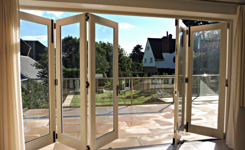 brilliant use of bifold door opening up a room to a large patio area