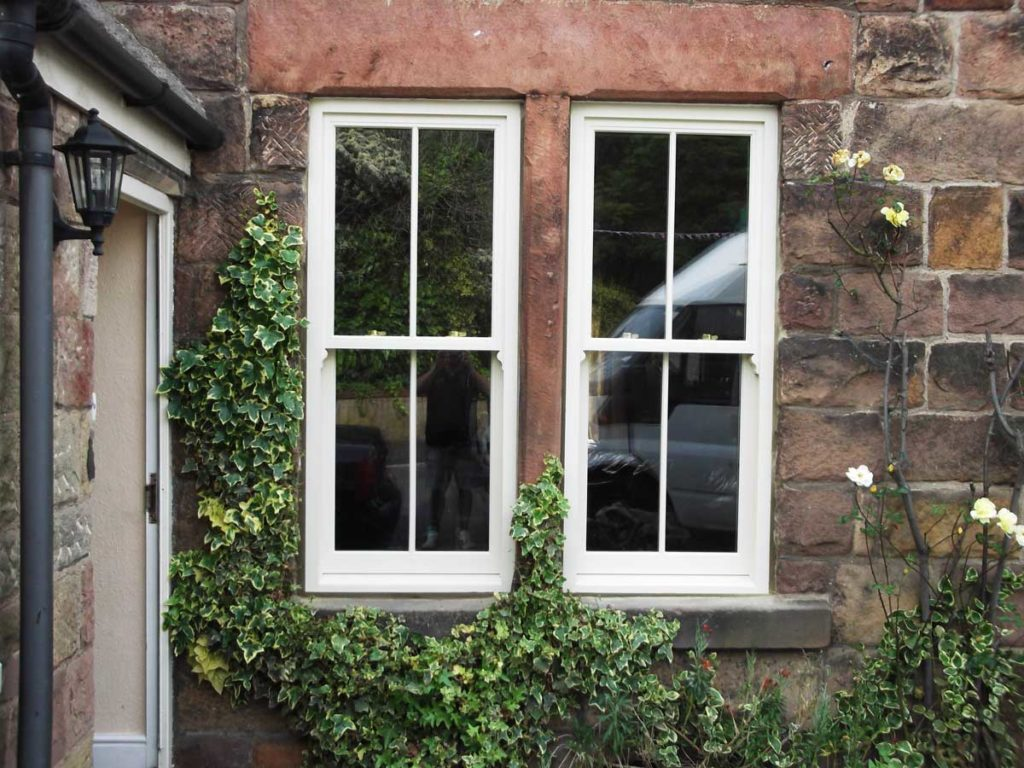 Double glazed sash windows installed in a traditional farm house